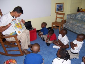 Mr. Sultan shows his K-3 group maps of the world.