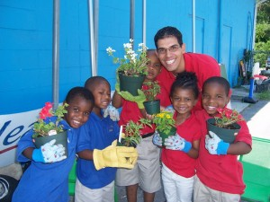 "Mr. Sultan and class show off their ""green thumbs""."