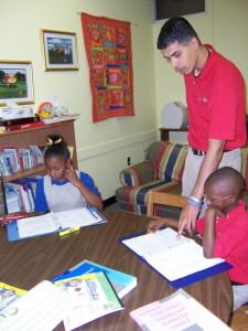 Mr. Sultan helps the second and third graders with advanced work.